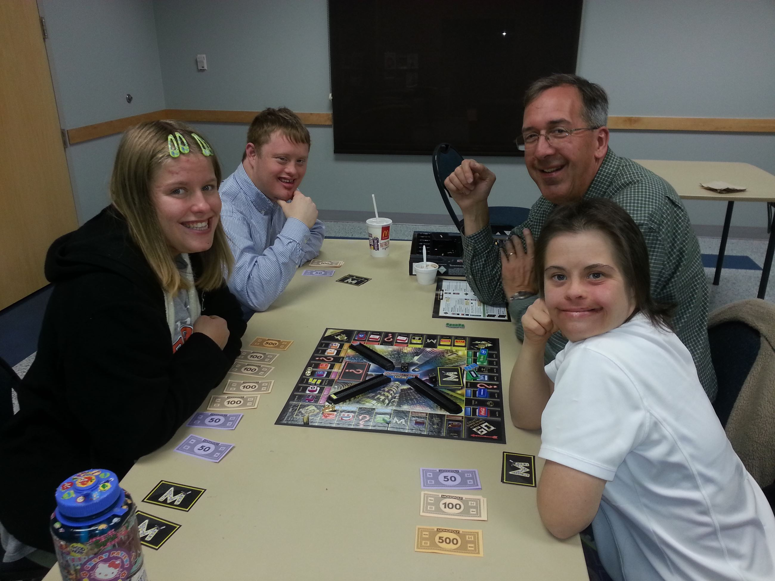 An adult and children playing a board game
