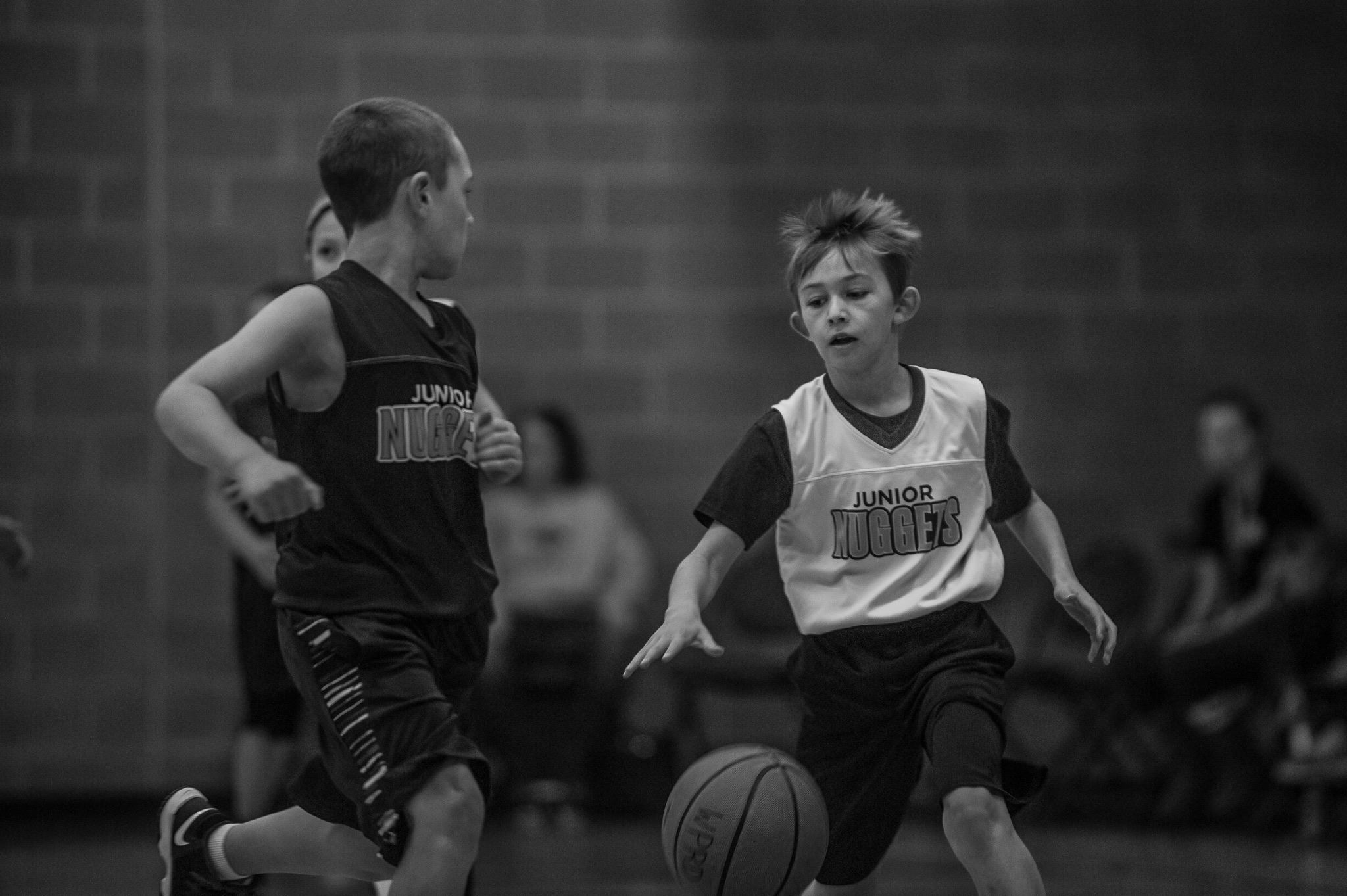 Boy Dribbling Basketball During Game