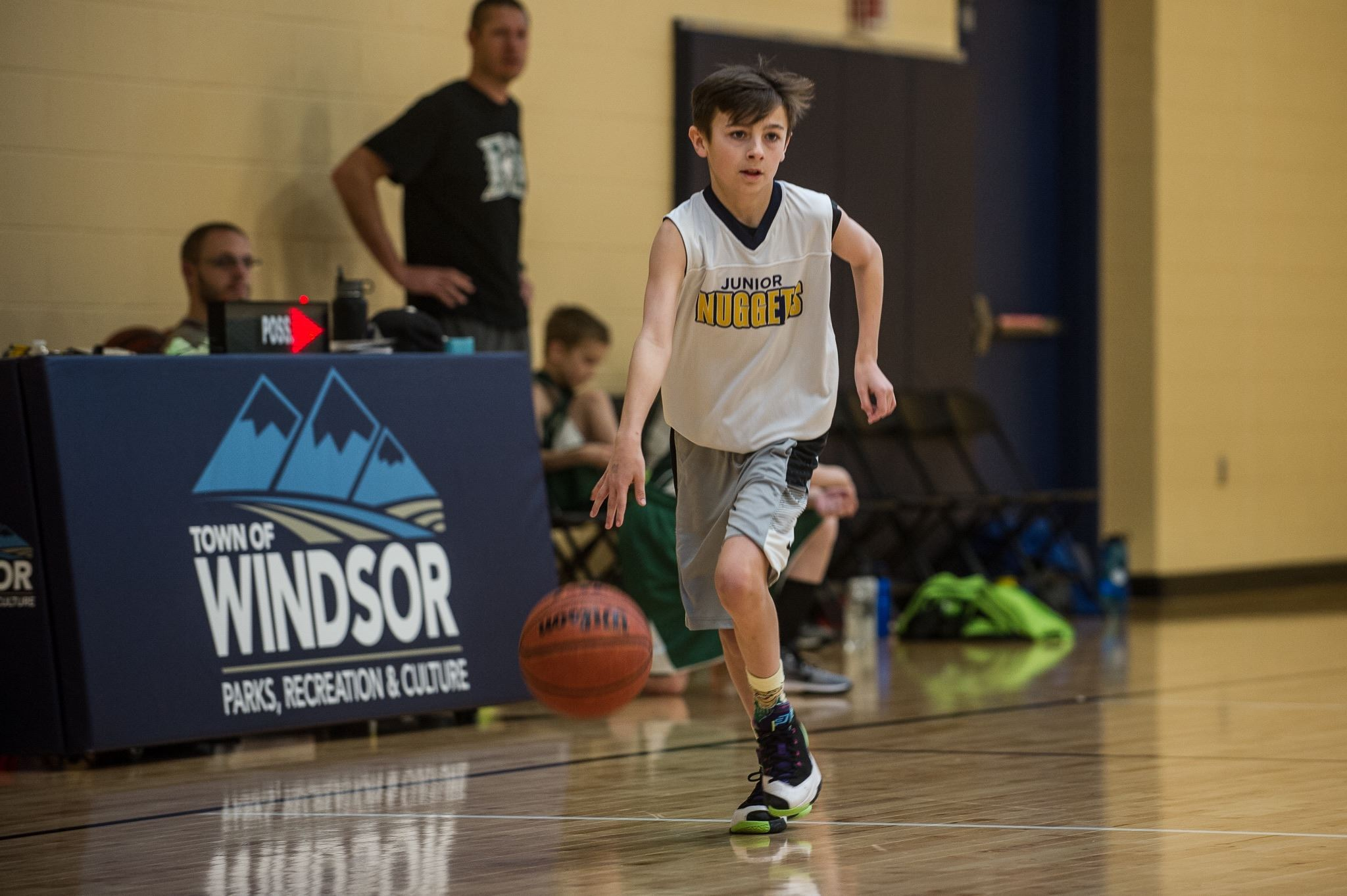 Boy Running and Dribbling Basketball