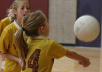 Girl Bumps Volleyball off Forearms
