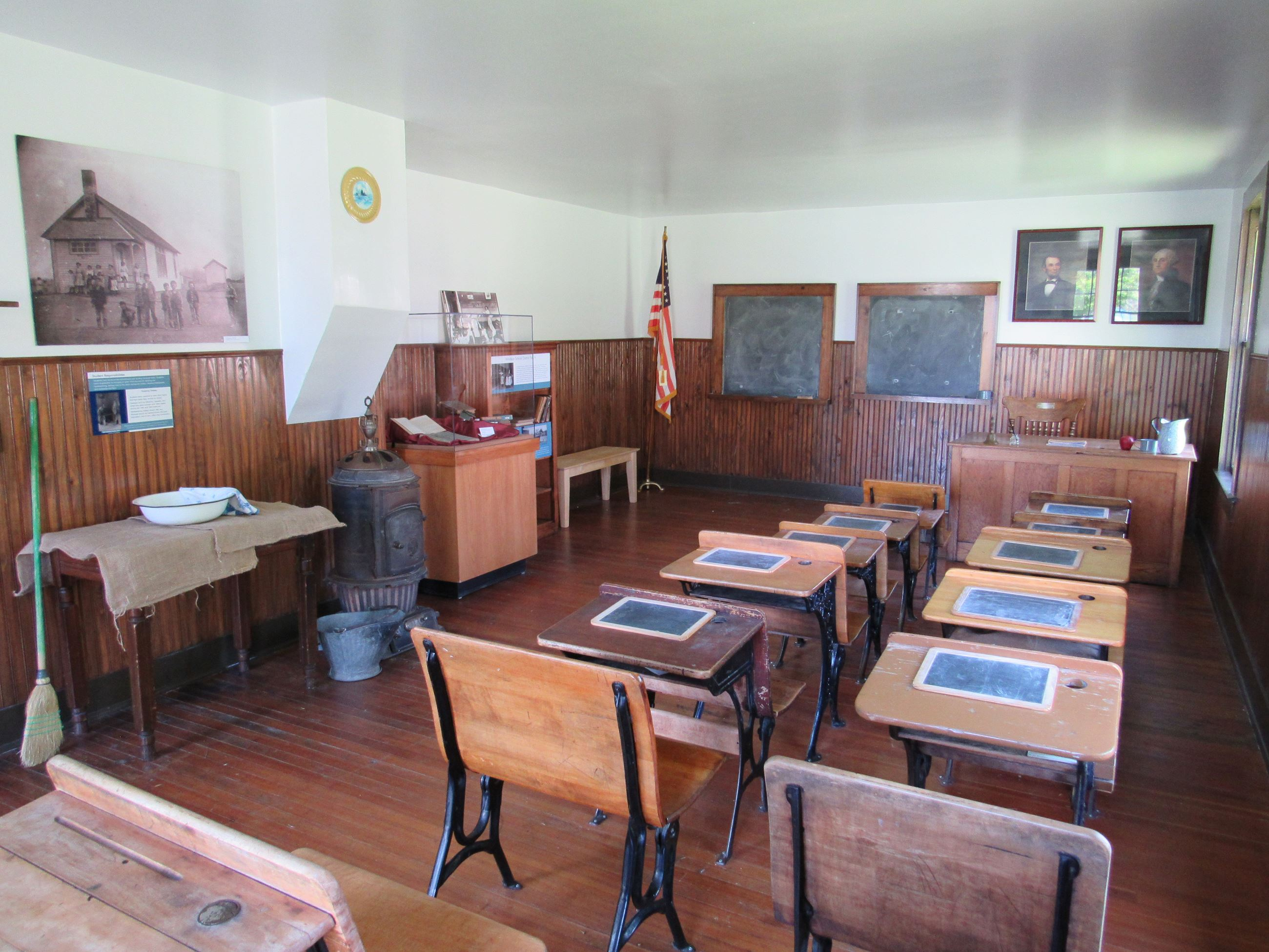 An old one-room schoolhouse with desks